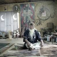 Keeping culture alive: Ainu ekashi (elder) Haruzo Urakawa sits in his self-built cise (traditional Ainu home), which serves as a meeting place and center for the dissemination of Ainu culture in Kimitsu, Chiba Prefecture. | LAURA LIVERANI / LUNCH BEE HOUSE