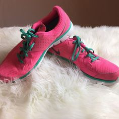 Nike Fitsole pink and mint sneaker shoes Size 9.5. Great condition except for some scuffs and dirt on the white portion of the shoes..along the bottom. Silver Nike checks on the shoes. Beautiful, bright pink! no trades Nike Shoes Sneakers