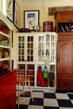 Love this mud room... and especially love the idea of removing the doors on the bottom half of a disused armoire... hanging purses.... glass shelves for shoes... another good idea to print out and tuck into your copy of Shop Sizzle from http://TGtbT.com/shop.htm