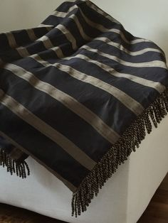 A personal favorite from my Etsy shop https://www.etsy.com/listing/263357639/manhattan-black-and-gold-luxury-throw