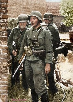 Tired German Soldiers during a battle.  They are SS but their collar insignia were been removed or retouched. Note the MP35 SMG of the leader. Pin by Paolo Marzioli