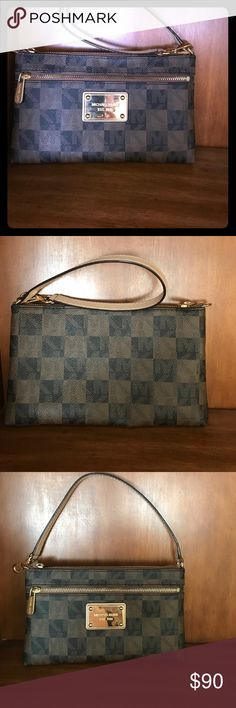 Michael Kors Jet Set Logo Checkerboard Wristlet Jet Set Logo Checkerboard Wristlet MICHAEL KORS STYLE #32T4GTTW3I Can wear as wristlet or small purse literally used once ! Has been sitting on a shelf ever since Michael Kors Bags Clutches & Wristlets