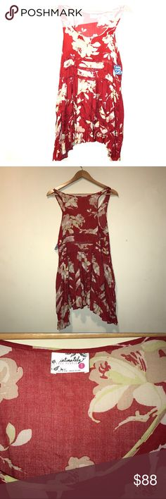 NWT FREE PEOPLE  TRAPEZE SLIP TANK DRESS/TOP XS NWT FREE PEOPLE  TRAPEZE SLIP TANK DRESS/TOP XS trade value is Apx -25% of MSRP if NWT attached. Or UNless WE come up w a HAPPY EQUAL TRADING ARRANGEMENTS!! Great TRADE REVIEWS AND STATS!! Free People Dresses Asymmetrical