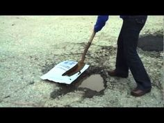 This demonstrates asphalt repair in a water-filled pothole.