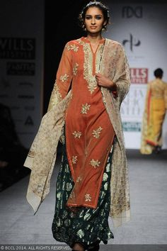 Archana walks the ramp for designer Vineet Bahl on Day 1 of Wills Lifestyle India Fashion Week (WIFW) autumn-winter (AW) 2014, held in Delhi, on March 26, 2014.