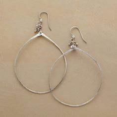 "CAVIAR DREAMS HOOPS -- In these silver beaded hoop earrings, caviar beads of pure silver garnish lengthy teardrop hoops hand forged of sterling. Made in USA with French wires. Approx. 2-1/2""L. Length and shape may vary slightly due to handmade nature."