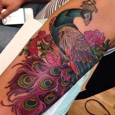 creative tight peacock tattoo on half sleeve