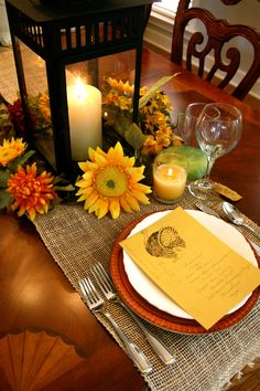 For a Thanksgiving centerpiece. Black lantern, fake fall blooms and a natural burlap runner...