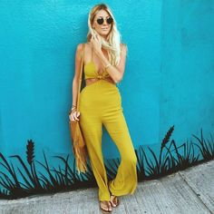 Team your summer love jumpsuit with platforms and a vintage crossbody.