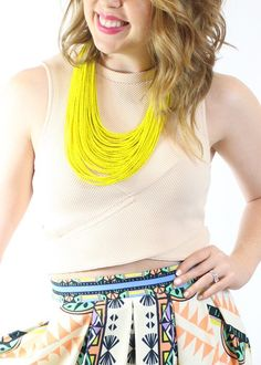 Blush polyester open sidecrop top. Fitted andtrue to size.Model is 5'2and wearing a small.