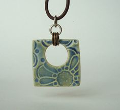 Artgirl56: Pure Porcelain Abstract Flower Ceramic Pendant in Opal Blue Green. $12.50, via Etsy.