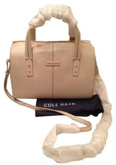 Cole Haan Ivory Beige Winter White Leather Large Emma Tote Crossbody Handbag Purse Satchel. Save 31% on the Cole Haan Ivory Beige Winter White Leather Large Emma Tote Crossbody Handbag Purse Satchel! This satchel is a top 10 member favorite on Tradesy. See how much you can save GORGEOUS NEW BAG!!! SALE!!! WOW!!!