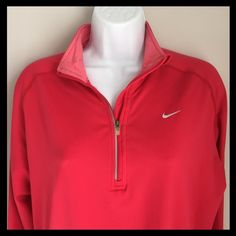 """NIKE Dri-Fit Long Sleeve Half Zip Nike Dri-Fit long sleeved, half zip workout shirt. Dri-Fit technology wicks away moisture to keep you dry and comfortable while running or working out. This is more watermelon pink than red with contrasting pink at neck. Loop on back of neck is for """"cord control"""" (Nike thinks of everything!). Excellent Condition! 213201635 Nike Tops"""