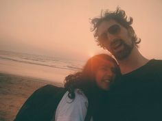 We make funny faces after a day of writing at a beach shack. Short one and tall one. We're happy. Sea in the background sunset bursting into my hair. #goanway #meandyou #morjim