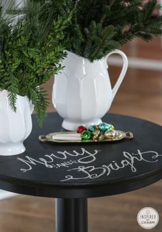 Black painted table with a chalkboard top! Perfect for seasonal messages. #12days72ideas http://www.inspiredbycharm.com