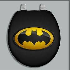 Spray paint or buy a black toilet seat and attached batman decal or you can spray paint a cut out of the batman sign.