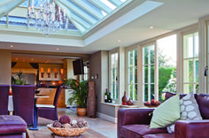 A soft lounge area within and orangery made more luxurious with the addition of a chandelier