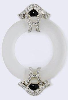 An art deco rock crystal, black onyx and diamond brooch, circa 1935.