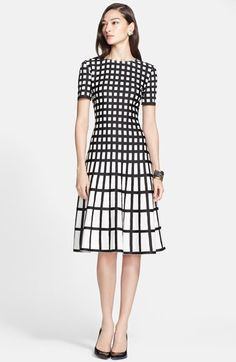 "Free shipping and returns on St. John Collection Tubular Box Knit Flared Dress at Nordstrom.com. <p><B STYLE=""COLOR:#990000"">Pre-order this style from the Resort 2015 collection! Limited quantities. Ships as soon as available. You'll be charged only when your item ships.</b></P><br>A modern knit dress is designed in a graphic black-and-white grid pattern that grows wider toward the flared hem to visually narrow the waist and elongate the legs."