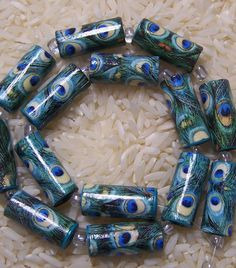 Handmade Paper Beads- Number 1 Top Seller Peacock Love Tube Style Beads Source by melitta_fischer Yo Make Paper Beads, Paper Bead Jewelry, Fabric Jewelry, How To Make Beads, Homemade Jewelry, Diy Jewelry Making, Bead Crafts, Jewelry Crafts, Quilling