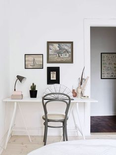 white washed desk area with green painted bentwood chair and art gallery wall. / sfgirlbybay