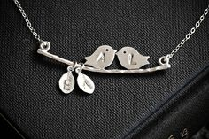 Family Necklace Two Initial Leaves and 2 monogrammed Birds (can add more leaves) $34.00, via Silver Lotus Designs Etsy.