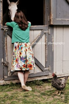 A young lady on the farm - photo by: alexis rae photography #horse #barn #seniorshoot #chicken #floral #dress