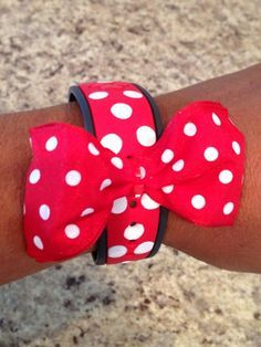 DIY Disney Magic Band I used white nail polish for the polka dots and added a wired ribbon bow with a tie wrap.