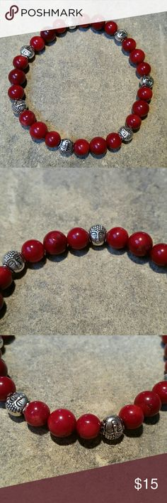 """Red Coral & Buddha Boho Meditation Mala Bracelet Beautifully hand crafted in Florida, NEW boho mala bracelet with 8mm genuine semiprecious red coral beads, accented with silver metal Buddha head beads. Perfect for crown chakra, meditation, spiritual, healing work, just enjoying it's beauty alone, or layering with my other stacker bracelets! Quality thick stretch beading cord. Inside circumference 7.5"""" unstretched. Unisex, Women's / Men's.  Thank you for visiting my closet, and happy poshing…"""