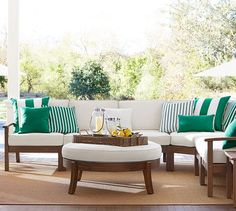 Chatham Sectional | Pottery Barn there are couches and lounging furniture, as well as a dining table and chairs