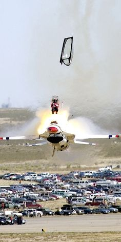 USAF Thunderbirds Captain Chris Stricklin ejects from his F-16.  There were no injuries on the ground, and the Captain walked away with scratches.  Not the jet though....