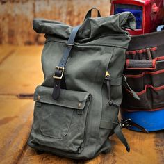 www.Filson.com | The brand-new Roll-Top Backpack features an easy-access side zipper, cinch-down roll-top closure and a lined interior.