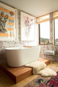 Shabby chic bathroom with ocean view [Design: Peter Jenny Design]