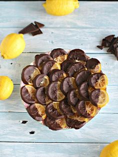 Vegan and gluten free these chocolate dipped candied lemon rounds are sweet, chewy and refreshing, finished with a dash of sea salt for a perfect snack.