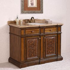 This elegant vanity has the ability to completely transform the decorative elements in your bathroom. Featuring hand-carved accents, this lovely bathroom vanity is an excellent blend of both form and function.