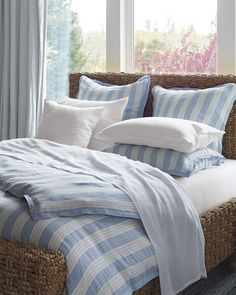 We love the breezy, coastal feel of this combination of a striped linen duvet cover and a bed made of chunky water hyacinth. Linen Duvet, Duvet Bedding, Comforter Sets, Gray Comforter, Bedding Decor, Cotton Bedding, King Comforter, Best Bedding Sets, Luxury Bedding Sets