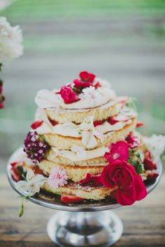 We love the messy, yummy, look of this cake, complete with bright flowers for a spring affair!