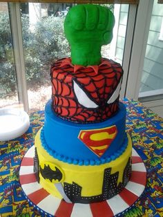 Big no-no mixing DC and Marvel (props to my children for my comic knowledge) but this is a great b-day idea for Julian, probably an Avenger's cake. Super Hero Cake  By: CakeCrazyShannon  Strawberry, vanilla chocolate chip and chocolate cake with vanilla buttercream. Rice crispy and fondant hulk hand.