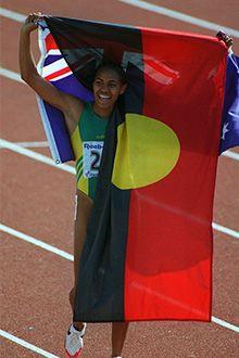 Cathy Freeman with aboriginal flag, 2000.