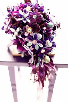 Description of a Handmade Felt Flower Bouquet and Boutonnieres (at Rebellious Brides diy Idea)