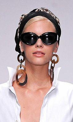 Daks S/S 2014..earrings!!  Love the look- but don't think I could pull it off!
