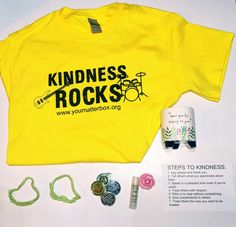 April's Kindness Kit has arrived. In a world where you can be anything, be kind! The Kindness Kit box included: kindness rocks tee, mini planter, friendship bracelets, friendship coins, lip balm/gloss. #youmatterbox You Can Be Anything, Rock Tees, You Matter, Kindness Rocks, Lip Balm, Friendship Bracelets, Lips, Eos Lip Balm, Friend Bracelets