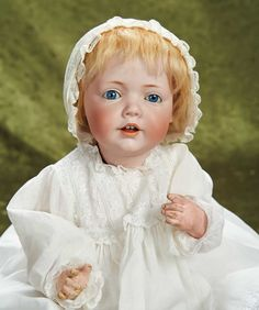 """Lot: 17"""" (43 cm.) German bisque character """"Hilda"""" by Kestner superb bisque and costume 1700/2500 