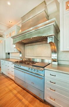 Pewter Countertops - beautiful ways pewter has been incorporated in kitchen designs - via South Shore Decorating Blog: Design Trend