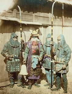 A late Edo period photograph showing kusari katabira (chain armor jacket) and hachi-gane (forehead protectors) being worn by three ashigaru (foot soldiers) along with a samurai wearing traditional armor.