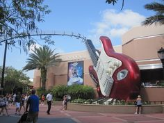 A giant red Fender Stratocaster greets Aerosmith enthusiasts outside the Rock 'n' Roller Coaster at Hollywood Studios.