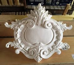 "A large plaster cartouche we made for the Breakers Hotel in Florida. We created 2 sizes for them: 35""x30"" and 50""x44""."