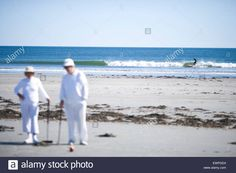 A Group Of People Playing Croquet On The Beach Stock Photo, Royalty Free Image: 84703728 - Alamy