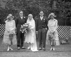Looking pretty as a picture in a short, scallop hemmed wedding dress and juliet cap veil of stunning lace, Joan Bacon married George Haddock on the 16 August 1927, at Brompton Oratory, London.