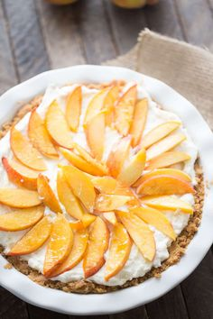 Fresh peach pie starts with a shortbread crust that is topped with a creamy mascarpone filling and then topped with fresh peach slices. .